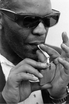 Ray Charles lighting his cigarette (tracking the heat with his little finger). Photo by Bill Ray, March 1966, shot at RPM in LA.