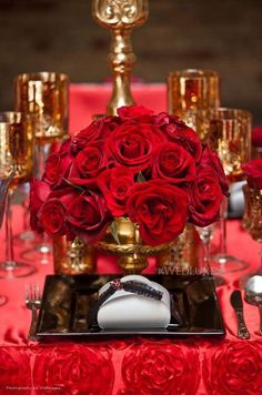 Red Roses in gold arrangement. Beautiful for the holiday season.