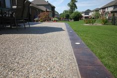 Check out some of Biondo Cement's most beautiful exposed aggregate patios, driveways, walkways and much more. Stamped Concrete Driveway, Resin Driveway, Concrete Backyard, Concrete Patio Designs, Concrete Driveways, Backyard Patio, Flagstone, Walkways, Exposed Aggregate Driveway