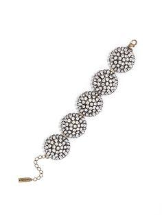 Oversized crystalline blooms add a feminine touch of sparkle to the wrist. #baublebar #swatstyle #bracelet