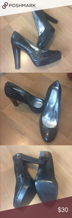 Calvin Klein platform heels Beautiful condition. Calvin Klein platform heels with textured fish scale design. Size 8 1/2 with about a 4 1/2 inch heel. Only real sign of wear is on the bottom of the shoe. Calvin Klein Shoes Platforms