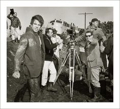 """Warren Beatty filming """"Mickey One"""", near Chicago, in March, 1964. The producer/director, Arthur Penn, is right of the camera."""