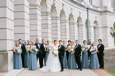 bride and groom with large wedding party bridesmaids in blue floor length bridesmaid dresses Blue Bridesmaids, Blue Bridesmaid Dresses, Wedding Dresses, Wedding Ceremony, Our Wedding, Wedding Parties, Wedding Ideas, Reception, Gold Color Palettes