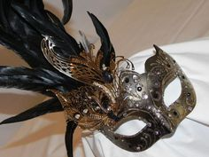 Feather Masquerade Mask in Black and Gold by TheCraftyChemist07 on Etsy!
