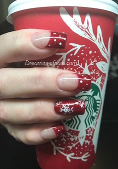 Red glitter French nails with painted snowflakes