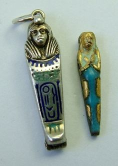 1920s Silver & Enamel Opening Sarcophagus Charm Mummy Inside 21mm (13/16ths of an inch) by 5mm (3/16ths of an inch) and weighs 1.4 grammes. Unmarked but tested as at least 800 grade silver with a secure closure. The mummy is only base metal. The outside was originally gilded but most of this has worn away otherwise it is in very good condition. 88gbp