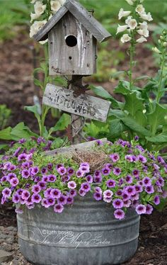 Fill a washtub with plants, add weathered bird house for country garden charm...