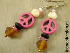 Great earrings !!  Peace-sign pink, glassbeads, bone beads, nickelfree.  For sale: www.ireneskralen.nl
