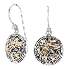 #720296. Round ornate leaf design dangle earrings in s/s w/ 18k y/g accents. For more information, contact us @ carmouchejewelers.com
