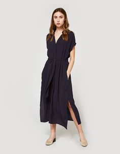 Easy dress from Stelen in Navy. Spread collar. V-neckline. Seamless short sleeves. Concealed front button closure. Detachable tie-belt at waist. Center front vent. Straight hem. Unlined. Casual fit.  • Crepe • 100% viscose • Dry clean