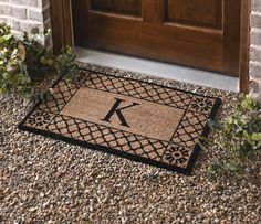 Kirkland's Lattice Monogram Door Mats are a beautiful and personal way to welcome guests into your home.