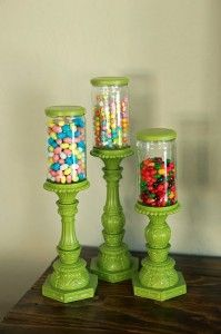 How fun would it be to have candy jars in your bedroom?  Can also be used to store hair ties, marker sets, etc... What you need: salsa jars + candles sticks + spray paint = adorable candy dishes :)