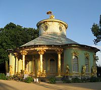 Various European monarchs, such as Louis XV of France, gave special favor to Chinoiserie, as it blended well with the rococo style. Entire rooms, such as those at Château de Chantilly, were painted with Chinoiserie compositions, and artists such as Antoine Watteau and others brought expert craftsmanship to the style.[3] Pleasure pavilions in Chinese taste appeared in the formal parterres of late Baroque and Rococo German and Russian palaces, and in tile panels at Aranjuez near Madrid. The…