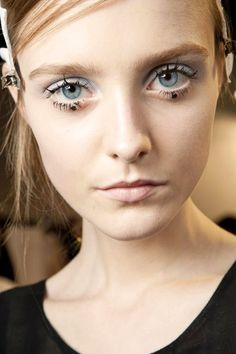 Trace the waterline with a white or nude eyeliner to make your eyes pop. With a gel eyeliner pencil, create a dot under the lash line in the center of both eyes.