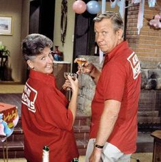"The Brady Bunch - Alice Nelson (Ann B. Davis) and her boyfriend Sam ""The Butcher"" Franklin (Allan Melvin) pose in their league bowling shirts."