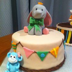 Baby shower cake, elephant, monkey and bunting.