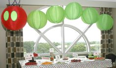Take a look at this Very Hungry Caterpillar themed birthday party on The Weekend Homemaker. The party favor/snack ideas are adorable.