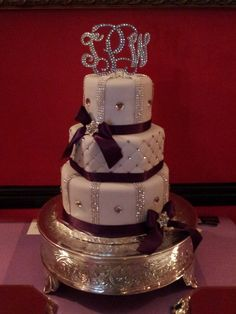 "Light and dark purple with LOTS of ""bling"" wedding cake! :)"