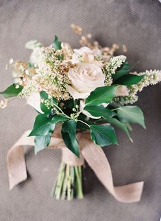 Simple ivory rose wedding bouquet wrapped with burlap ribbon. @myweddingdotcom