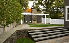 Coen + Partners Landscape Architects - Lake of the Isles residence | love the stone steps and walls of this backyard house
