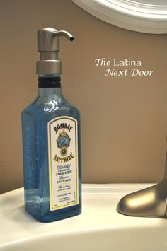 love our Bombay Sapphire soap dispenser: should match nicely with the shower curtain & light fixture