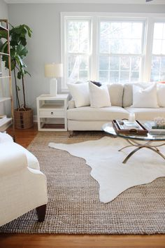 3 Simple Tips for Using Area Rugs in Rental Decor + Sources for Affordable Area Rugs Layering Rugs, Rugs For Living Room, Carpet In Living Room, Living Room Windows, Living Room Designs, Cozy Living, Living Room Decor, Cowhide Rug Decor, Faux Cowhide Rug