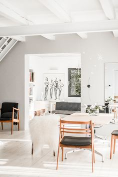 The dwelling showcases the designer's collection of Danish chairs and loungers from the 1940s, 50s, and 60s — including pieces designed by Kofod Larsen, J.L Moller, Harry Ostergaard, Bruno Mathsson, and Hans J. Wegner.