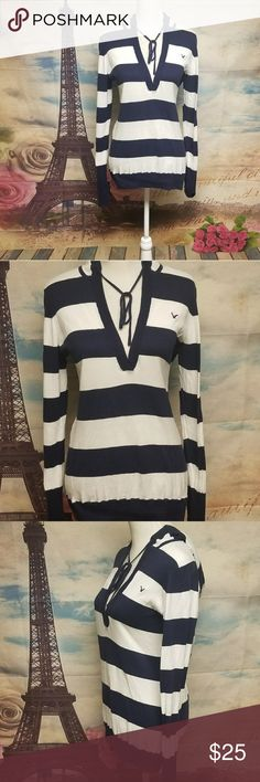 American eagle striped hoodie sweater Size XL Conditions EUC Color White/ Navy Blue  Material 100% Cotton  Shoulders  18 Chest 40 Length 27 Sleeves 29 ITEM P4TS50~13F93*Internal use only*  ▪ B2G1 free 💟 Bundle 3 items with a 💟 *free item will be the one with less or equal value*  ▪25% off 🛍 Bundle 4 or more items and get 25% off automatically with my seller discount price  **B2G1 NOT applicable***   ▪$4,99 SHIPPING 🚛 Bundle over $25   ▪FREE SHIPPING 🚛 Bundle over $50 American Eagle…
