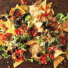 Loaded Veggie Nachos. Can have Avocado, Black Olives, Cheese, Spinach, Broccoli, etc. Meatless Monday.