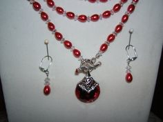 Check out this item in my Etsy shop https://www.etsy.com/listing/217582037/red-glass-pearl-necklace-set