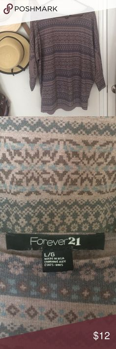 Forever 21 Tribal Sweater Cozy, lightweight sweater from Forever 21. Loose fit and very comfortable. Lightly used. Sleeves stop at wrists. Forever 21 Sweaters