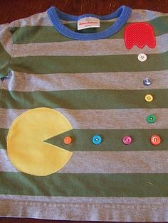 Super cute Pac man shirt for the boys!  NOT JUST FOR BOYS GOD DAMMIT.  Starla would love this with alternating pink and purple buttons.