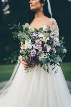 Garden style purple and white bridal bouquet.
