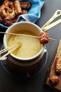 beer cheese fondue w/ pilsner, gruyère, cornstarch, dijon, worcestershire, paprika & fine sea salt, serve w/ pretzels, sliced german sausages, pickled garden vegetables & roasted brussels sprouts