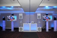 """After Hours Music and Entertainment - Long Island Weddings  Another glimpse of our white """"FROST"""" DJ set up! Creates the exact look you want with any color!  This setup includes the white speakers with the white basic light show, white light-up DJ front board, 2 white plasma screens, intelligent moving heads, and 4 vertical towers."""