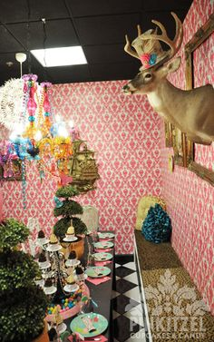 Cool fabric draped from the walls with empty frames On them for Mad Hatter party? Yes please.