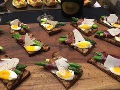 Dalton Hospitality | Jamon wrapped asparagus on rye with soft poached quail egg.