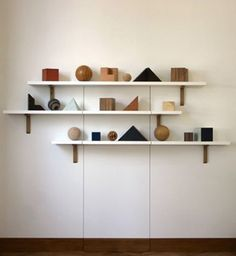 I like the simple but powerful placement of these shelves. The wood shapes are interesting too.