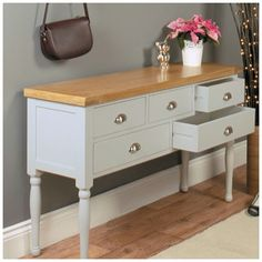 Grey Console Table with five Drawers. Made of solid wood with a lovely oak top. This Grey Furniture is ideal for the bedroom or Hallway. Can be used as a dressing table for the bedroom or console table.