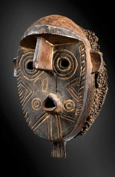 Africa | Old mask from the Gurunsi / Nuna people of Burkina Faso | Wood, pigment and natural fiber