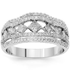 Sheer grace and femininity bring this 14KT white gold ring to life. Nine beautiful princess cut diamonds are tension-set in between  two parallel prong settings which feature round cut diamonds. Diamonds totaling to 1.37 ct, give this ring a gorgeously sparkling appearance. $1,779.00