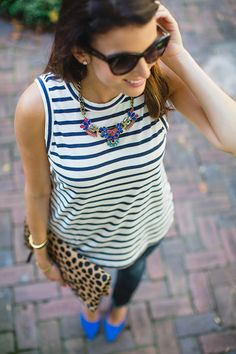Simple yet impactful. Dress up your striped tank with a leopard clutch, bold heels and a bright statement necklace.