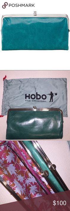 Like New Teal Hobo International Lauren Wallet Purchased this 2 weeks! Like New! Soft, textured leather in a two-sided design is perfectly proportioned for traveling light. Clutch opens at the center to reveal card slots, an ID window and a full-length zip pocket. Frame at one end has openings for more cards, while the frame at the other conceals a zip pocket. - Bifold construction with magnetic closure - Interior features1 zip pocket, 1 clear ID slot, and Color is teal-looks like first pic…