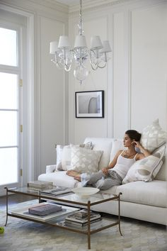 Lady enjoying a relaxing weekend afternoon in an all white living room.   Shot for http://www.serenaandlily.com/   © Laurie Frankel Photography