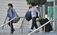 They've got baggage: Louis wheeled a huge suitcase out of the hotel, and juggled a large h...
