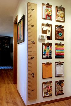 thrifted clipboards used to create a gallery wall for kids artwork, calendars, photos. For playroom. Diy Casa, Home And Deco, Kid Spaces, Small Spaces, Photo Displays, Display Photos, Home Organization, Calendar Organization, Diy For Kids