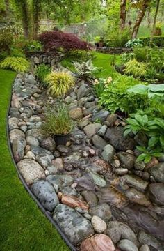 If your property has some serious water drainage issues and no way to neatly guiding it away from your house, then try expanding the scale of a dry creek bed idea. Same rules apply, but having a massive dry creek river will surely handle the abundant water flow. by jenifer