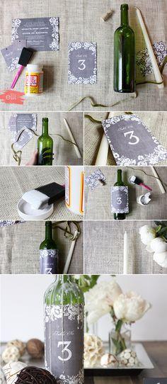 DIY Wedding Table Numbers: Wax Decorated Wine Bottles