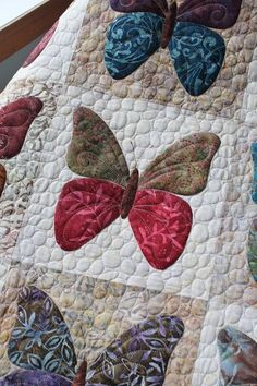 Back in October I shared a post here on my Butterflies quilt and this week I was able to quilt it up and even get the binding on! ...