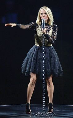Carrie Underwood from The Big Picture: Today's Hot Pics  Chained to the stage! The country singer performs in Oklahoma City.